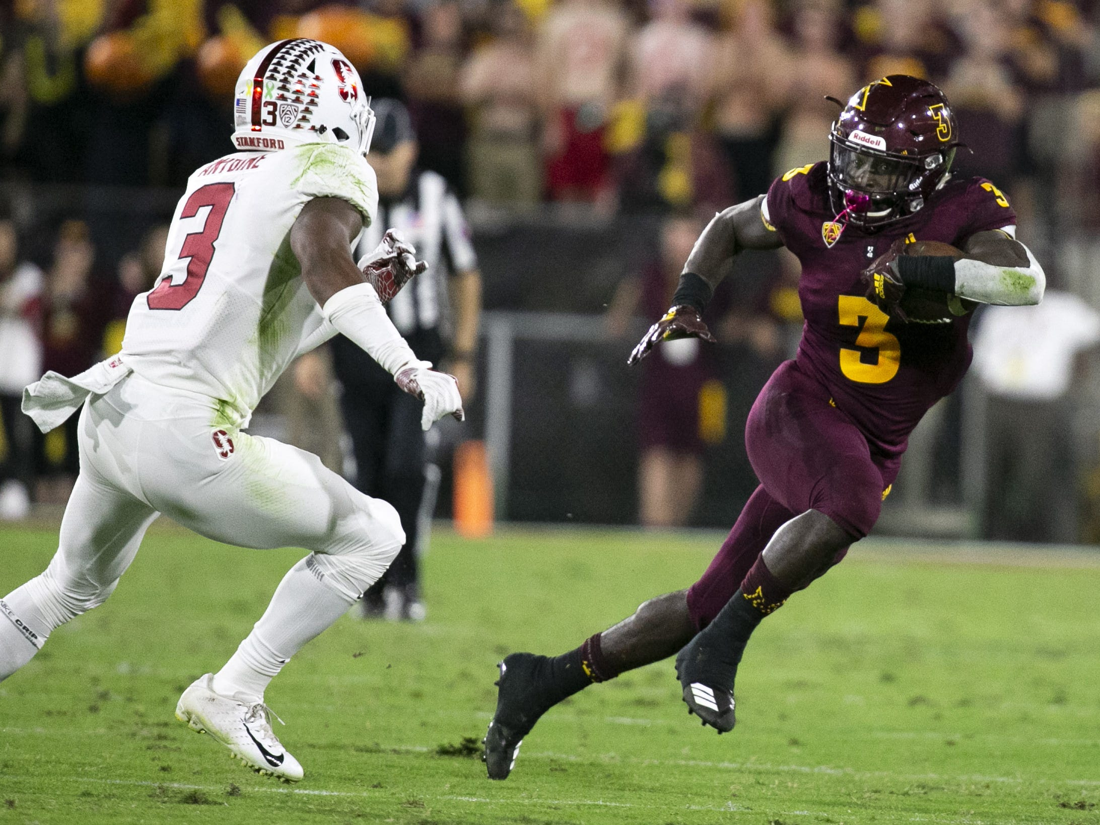 ASU running back Eno Benjamin carries the ball against Stanford safety Malik Antoine during the first half of the Pac-12 college football game at Sun Devil Stadium in Tempe on October 18, 2018.