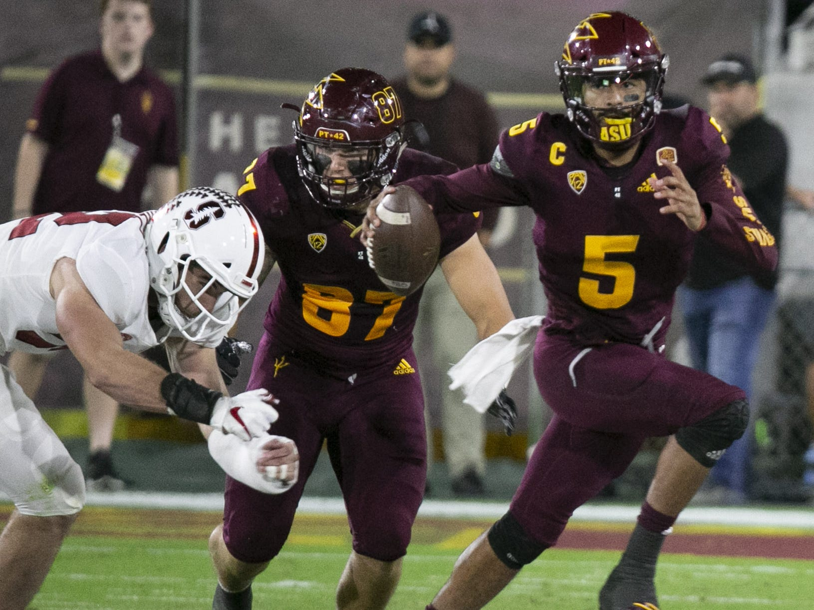 ASU quarterback Manny Wilkins carries the ball against the Stanford defense during the second quarter of the Pac-12 college football game at Sun Devil Stadium in Tempe on October 18, 2018.