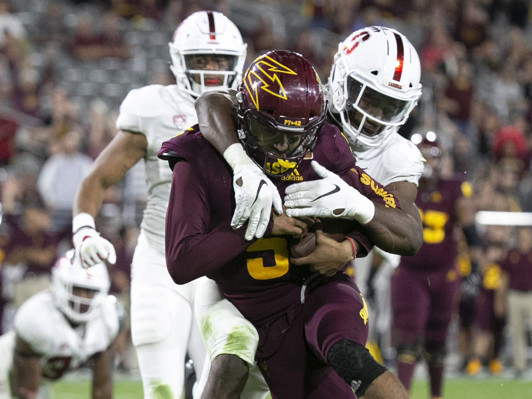 ASU quarterback Manny Wilkins scores a touchdown on the run as Stanford linebacker Bobby Okereke attempts the tackle during the  fourth quarter of the Pac-12 college football game at Sun Devil Stadium in Tempe on October 18, 2018.