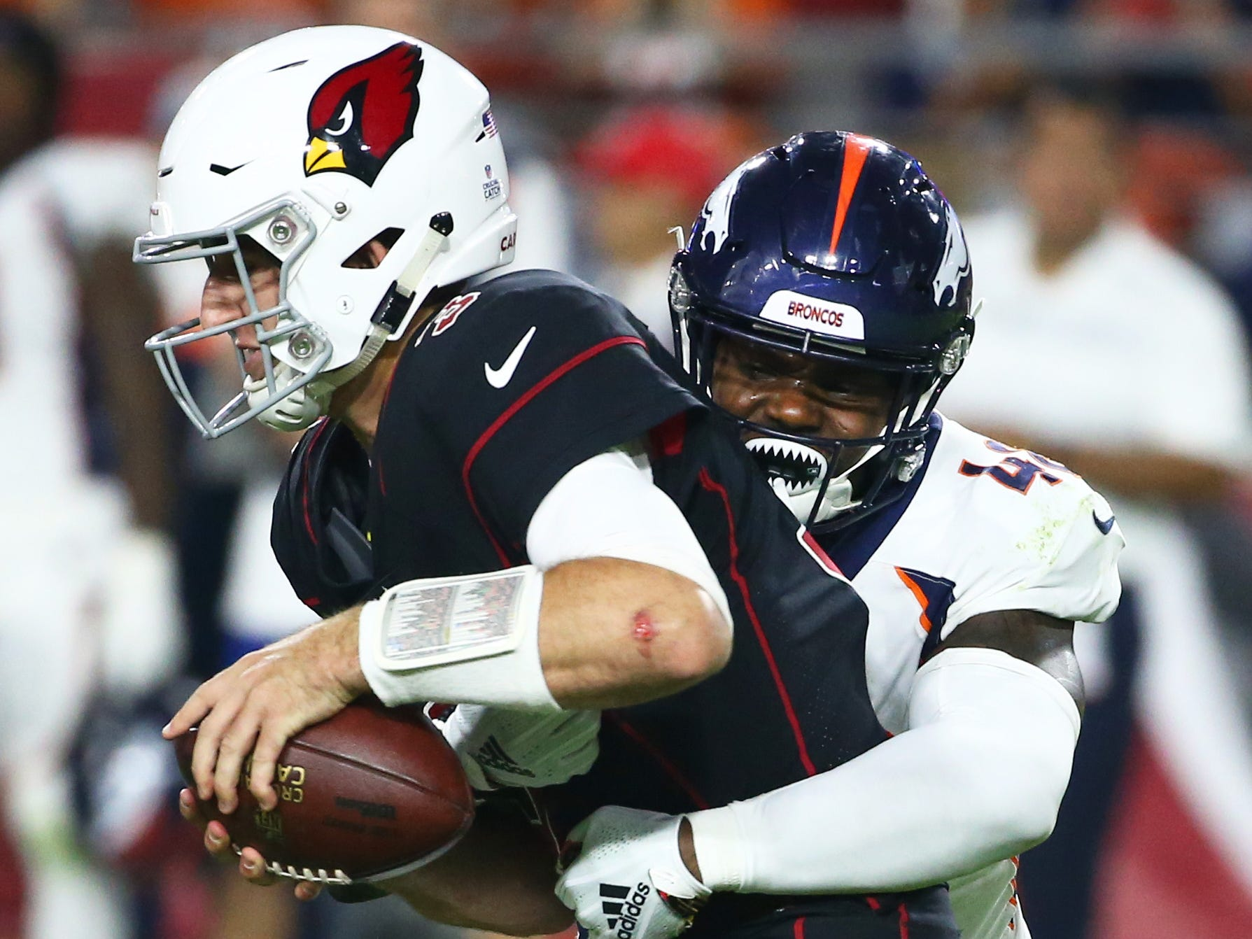 Arizona Cardinals Josh Rosen is sacked by Denver Broncos Shaquil Barrett in the first half at State Farm Stadium in Glendale, Ariz.
