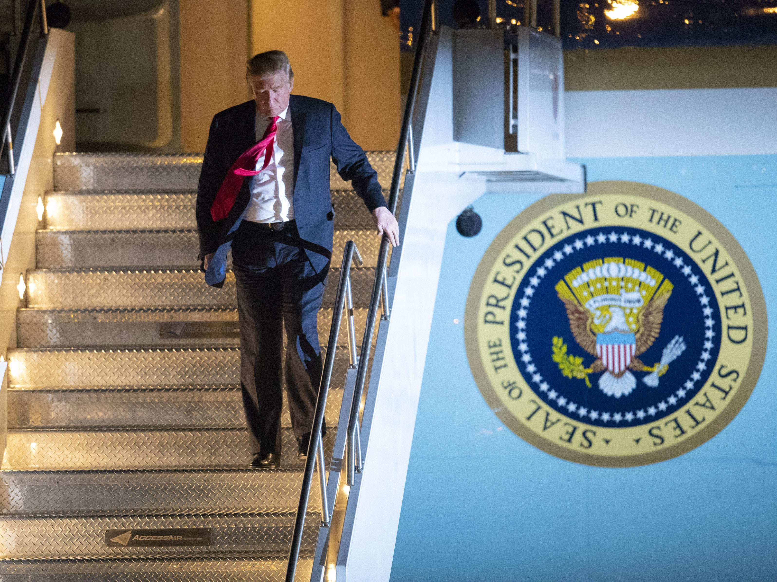 President Trump walks off Air Force One after arriving at Phoenix Sky Harbor Airport Oct. 18, 2018. The president is in the Phoenix area for events on Friday including a rally in Mesa for Republican senate candidate Martha McSally.