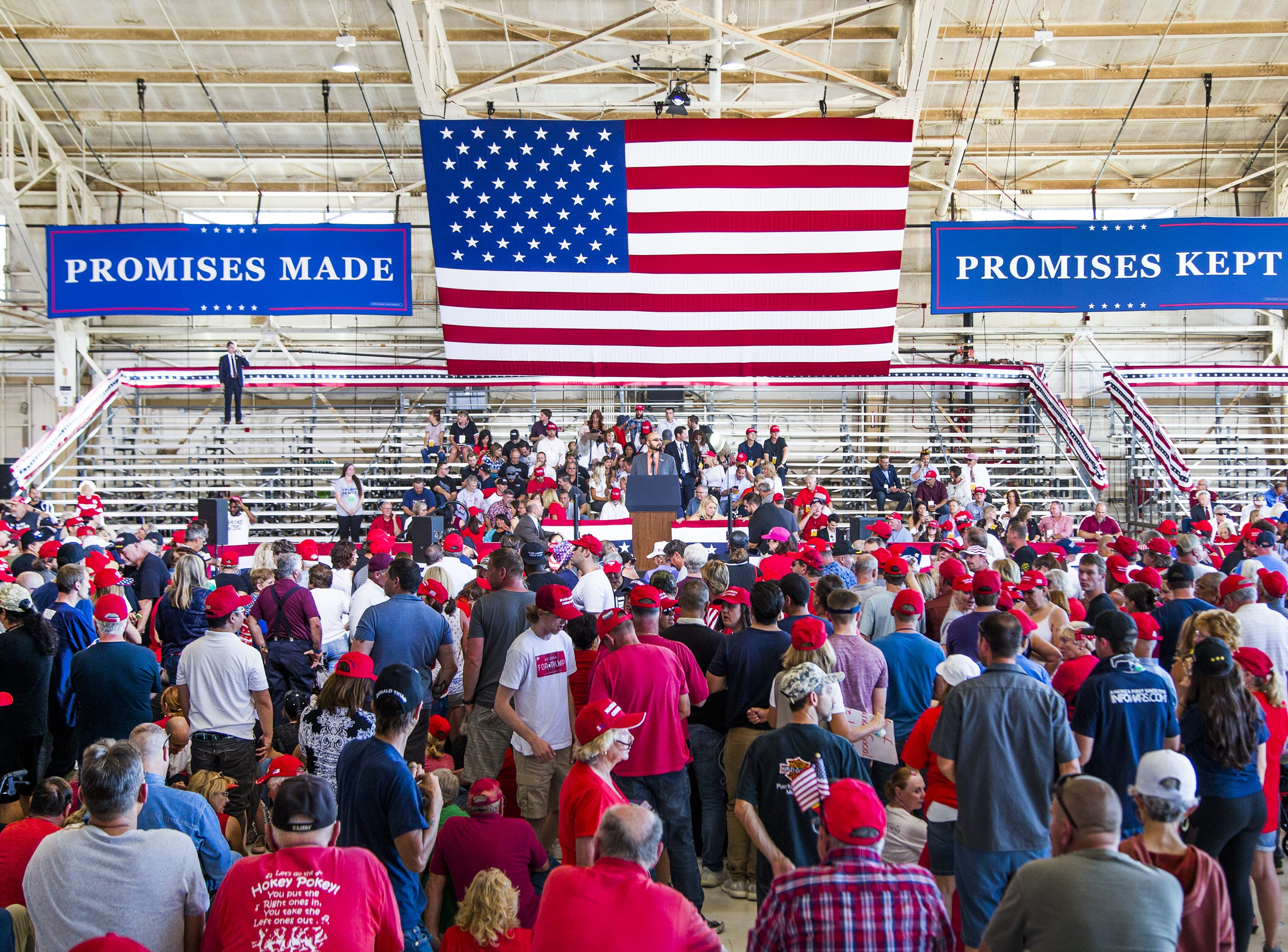 Fans of the president wait inside the International Air Response Hangar at Phoenix Mesa Gateway Airport, Oct. 19, 2018.  President Donald Trump is to appear Friday evening for a rally supporting Senate candidate Rep. Martha McSally.