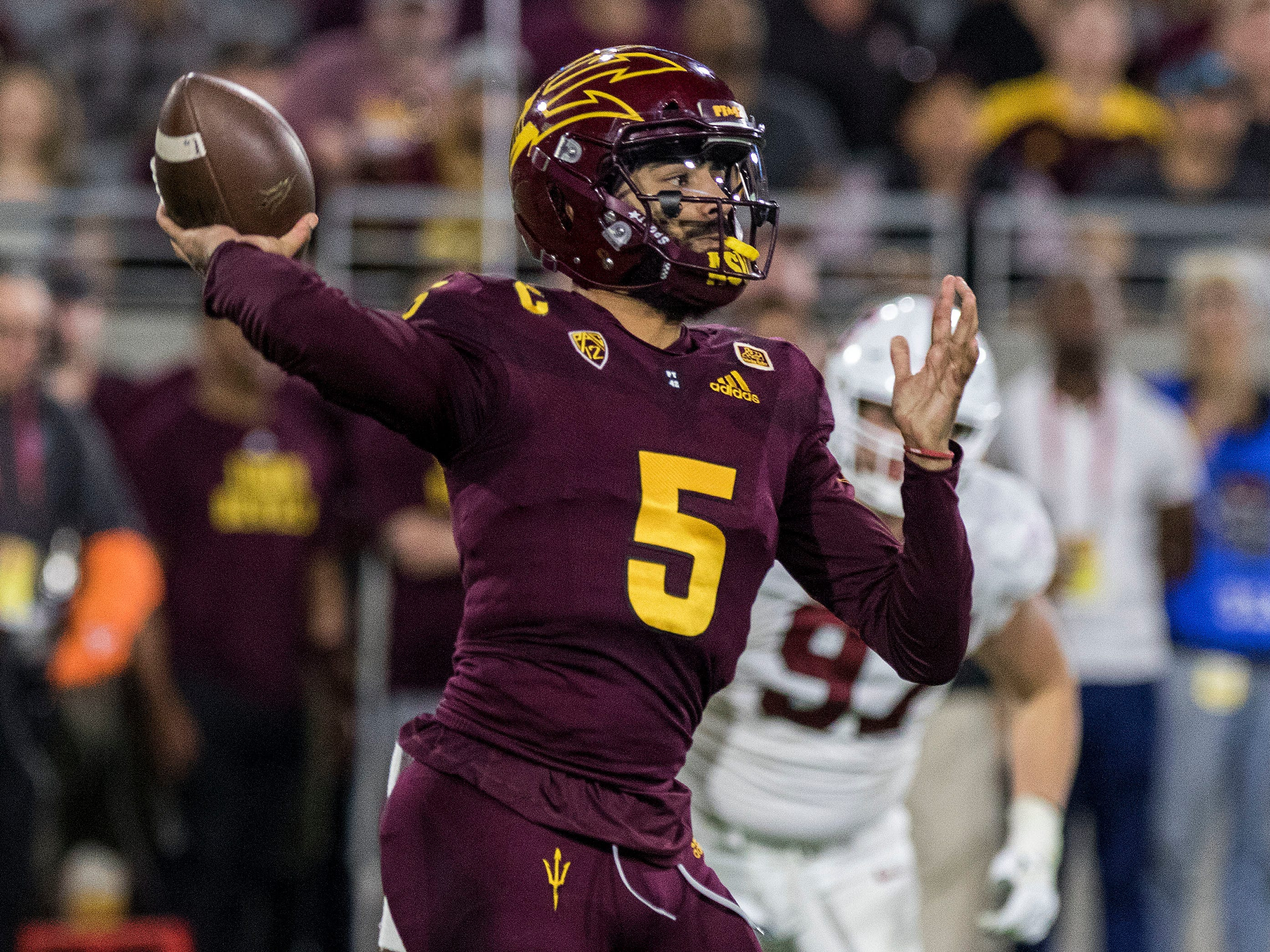 Arizona State quarterback Manny Wilkins throws a pass against the Stanford defense during the first half of an NCAA college football game Thursday, Oct. 18, 2018, in Tempe, Ariz.