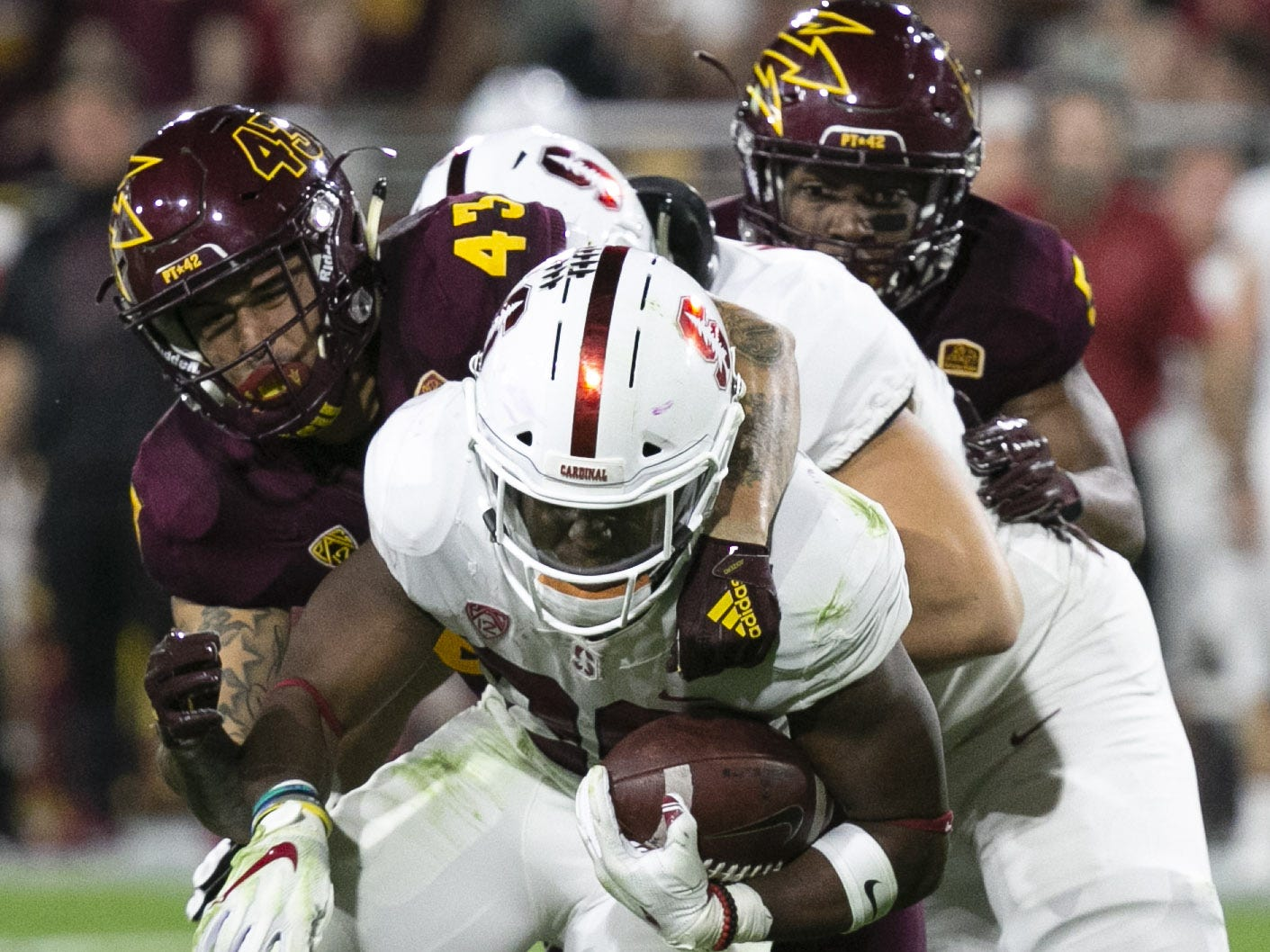 ASU defensive lineman Jalen Harvey tackles Stanford running back Bryce Love during the first quarter of the Pac-12 college football game at Sun Devil Stadium in Tempe on October 18, 2018.
