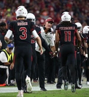 Arizona Cardinals offensive coordinator Mike McCoy reacts after Larry Fitzgerald made a touchdown catch gainst the Denver Broncos in the second half at State Farm Stadium in Glendale, Ariz.