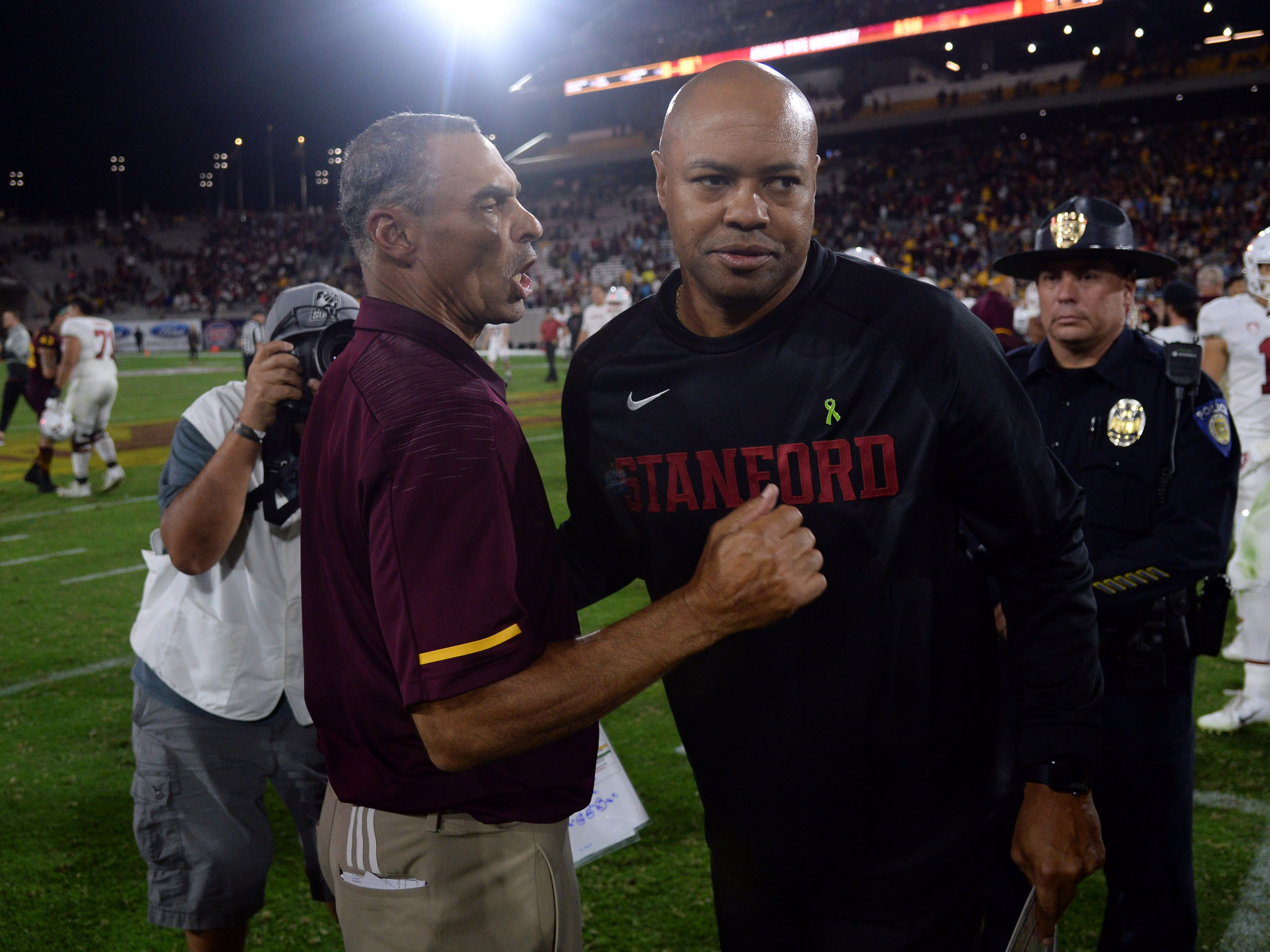 Oct 18, 2018; Tempe, AZ, USA; Arizona State Sun Devils head coach Herm Edwards (left) and Stanford Cardinal head coach David Shaw (right) shake hands after the game at Sun Devil Stadium.