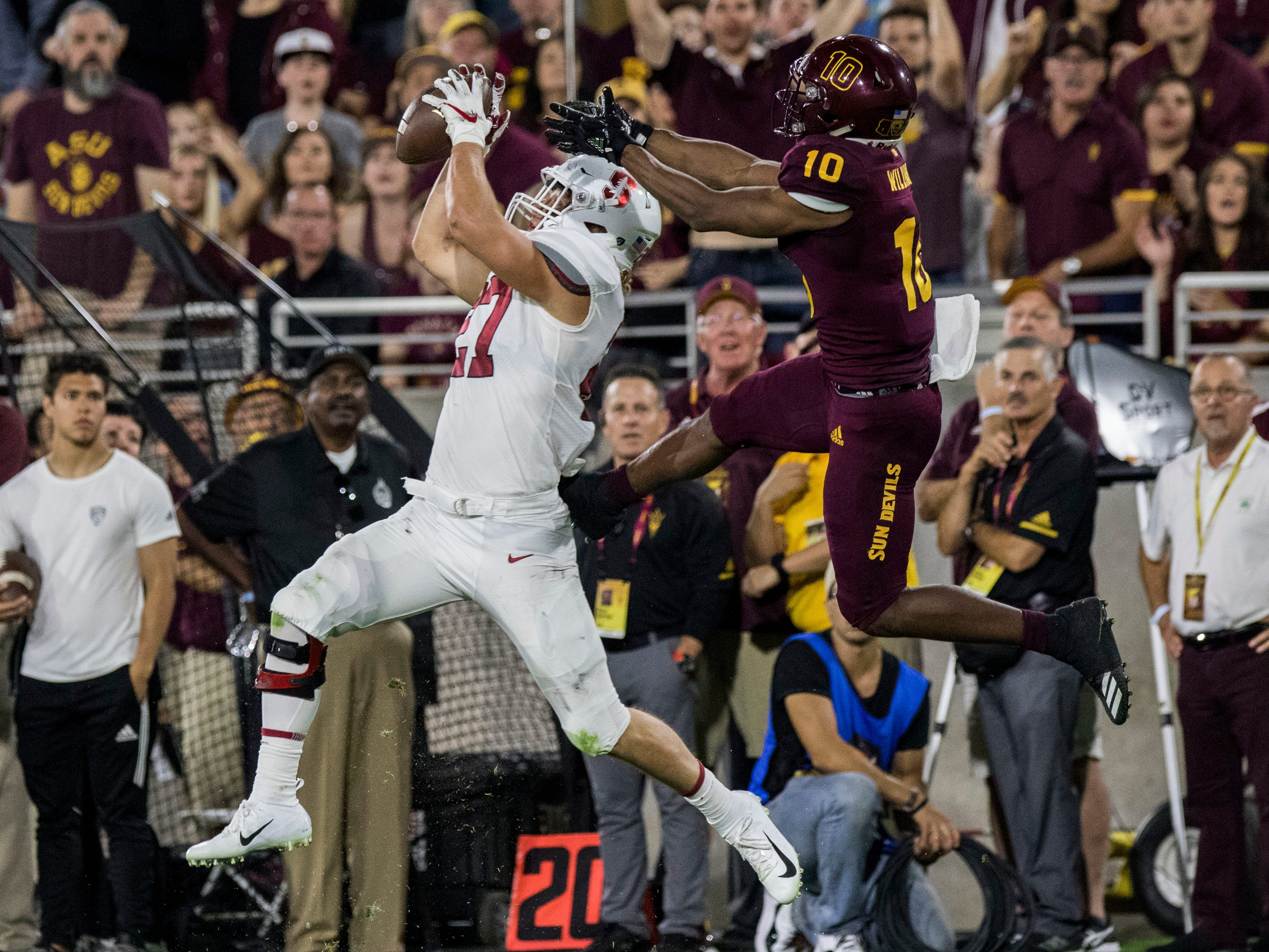 Stanford's Sean Barton intercepts a pass intended for Arizona State's Kyle Williams during the first half of an NCAA college football game Thursday, Oct. 18, 2018, in Tempe, Ariz.