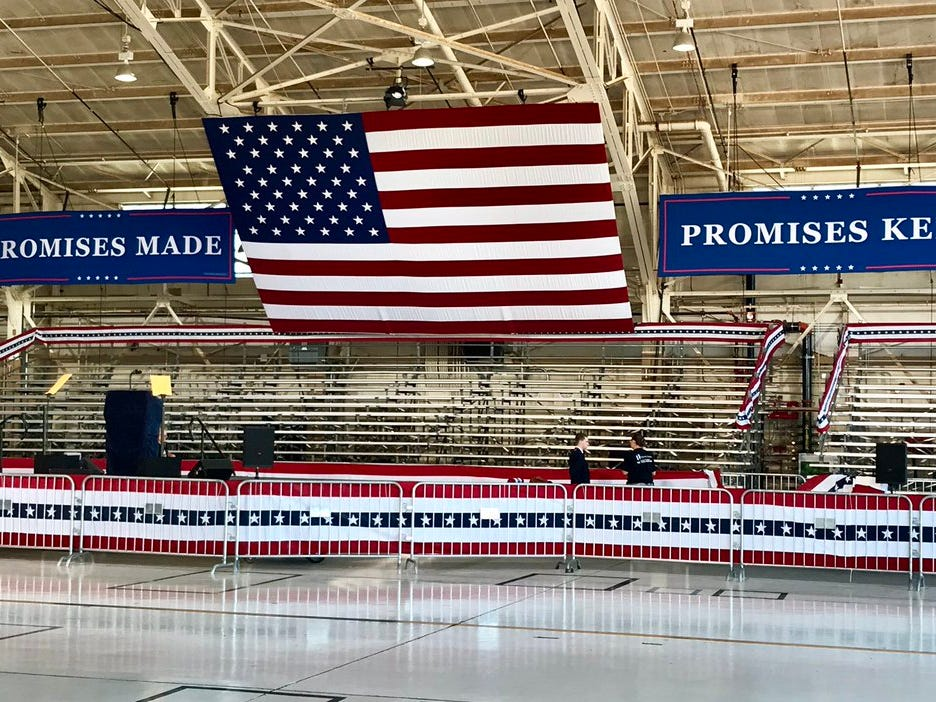 The stage is set in a hangar at Phoenix-Mesa Gateway Airport for a rally with President Donald Trump on Oct. 19, 2018.