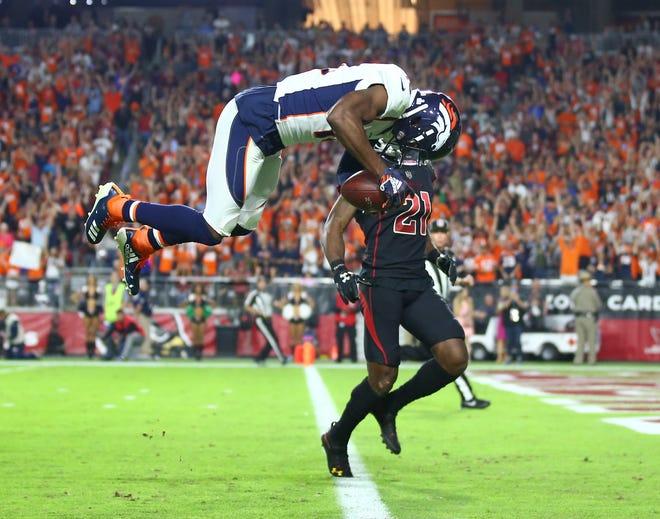 Oct 18, 2018; Glendale, AZ, USA; Denver Broncos wide receiver Emmanuel Sanders (10) does a front flip across the goal line to celebrate a second quarter touchdown against the Arizona Cardinals at State Farm Stadium.