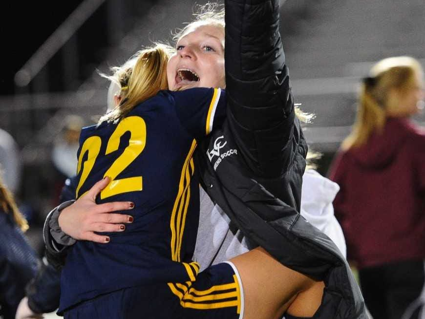 Elco player Jennifer Axarlis (22) gets a hug from assistant coach Amy Thome after the big win.