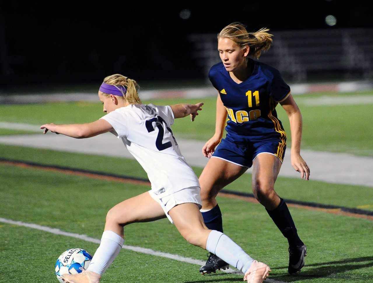 Elco's Julia Nelson (11) defends against CV's Madison Delgado (21) during the second half of play. Photo Jeff Ruppenthal.
