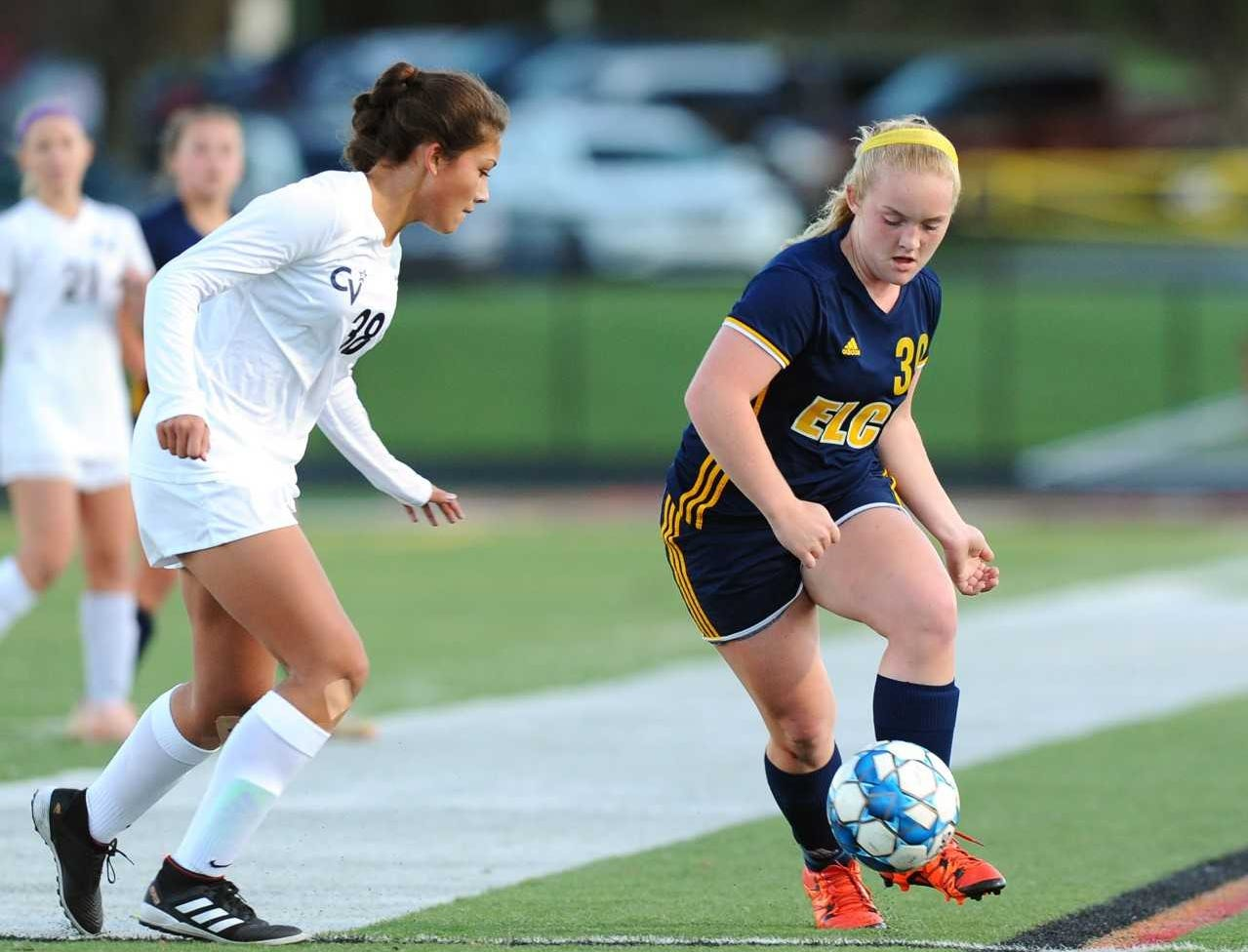 Emma Fox (39) of Elco moves the ball past CV's Delainey Varela-Keen (38) during the first half of play.