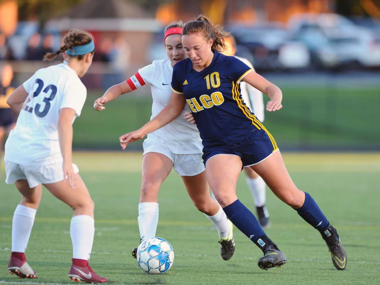 Ryelle Shuey (10) of Elco tries to go between CV's Megan Slingluff (23) and Reese Lapp (17) during the first half of play.