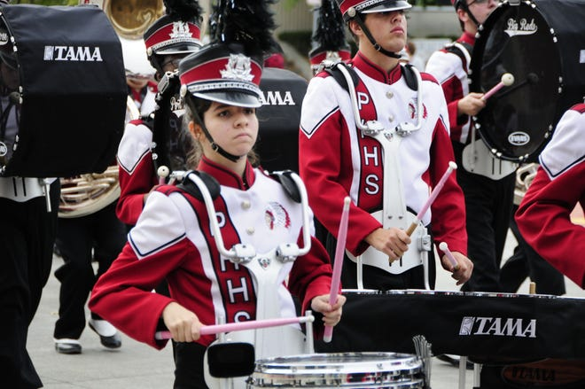The Big Red Marching Machine was part of the school's Homecoming Parade on Friday.