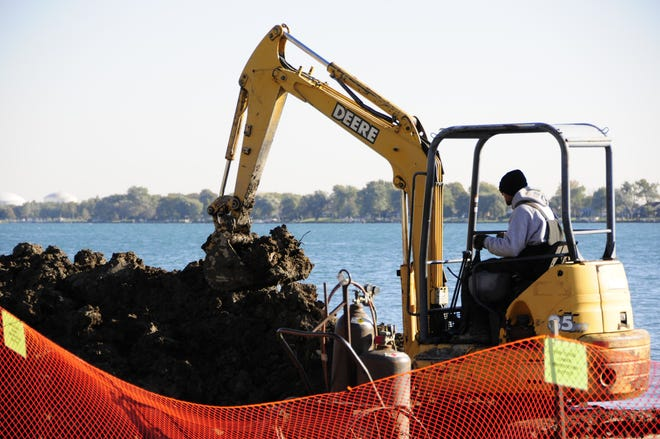 Workers from SA Fiscelli repair a seawall at River Park in East China Township.