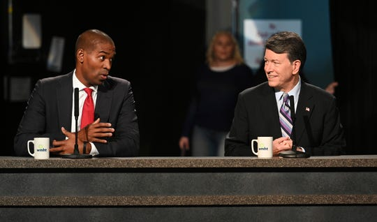 Candidates for the19th Congressional District Antonio Delgado and incumbent John Faso prepare for their debate at the studios of WMHT-TV, Friday Oct. 19, 2018 in East Greenbush, N.Y. (