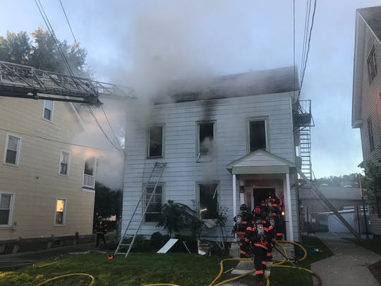 Multiple agencies responded to a fire on LaGrange Avenue in the town of Poughkeepsie at a three-story home Friday.