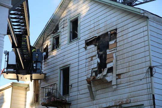 A three-story home in the town of Poughkeepsie was damaged by  fire on Friday. The tenants were displaced.