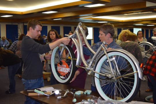 """Nearly 270 employees of F&M Trust decorated and stuffed 43 blue duffel bags withteddy bears, blankets, hygiene kits, coloring books and crayons and built 43 bicycles for foster children in southcentral Pennsylvania on Oct. 18 at """"Banktoberfest."""""""
