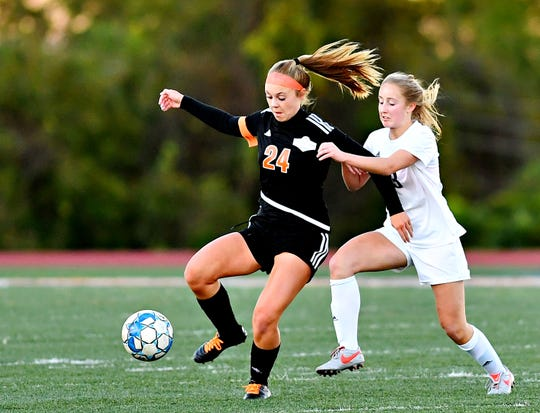 Central York's Madi Davis, left, controls the ball while Dallastown's Caroline Much defends. Davis was named the York-Adams Division I Co-Player of the Year by the coaches. Dawn J. Sagert photo