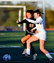 Central York rising senior Chloe Carns, left is shown here in a file photo against Dallastown last season. Carns has committed to play at Bloomsburg University.