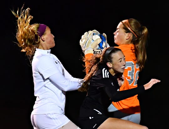 Central York goalkeeper Morgan Wood, at right in a file photo, makes a stop last season against Dallastown. The junior has committed to play NCAA Division I soccer at William & Mary.