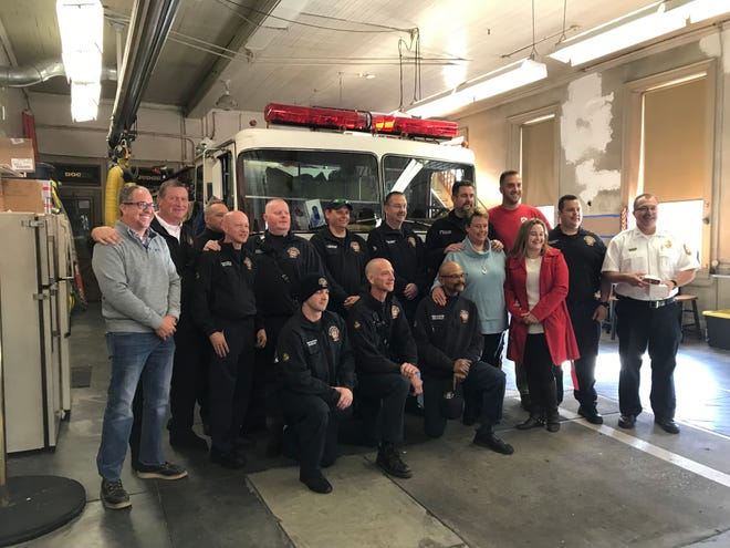 Firefighters with York City Fire/Rescue Services pose for a photo with Chris Mowry, top right, a firefighter at York Area United Fire and Rescue, who gave the department supplies to help prevent occupational cancer on behalf of the Carney Strong Initiative. Friends of York firefighter Timmy Bair, a 29-year veteran who recently died of brain cancer related to his fire service, are also in the group.