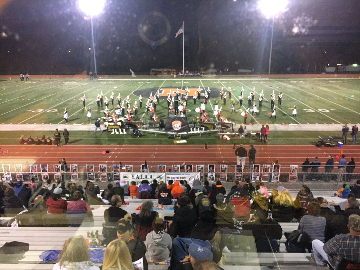 Northeastern's band warms up the crowd ahead of Friday's game against York High.