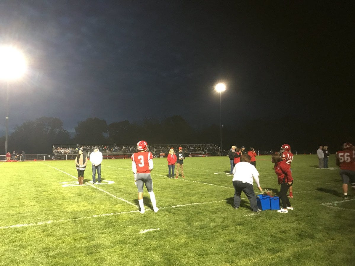 Annville-Cleona seniors are honored before Friday night's football game.
