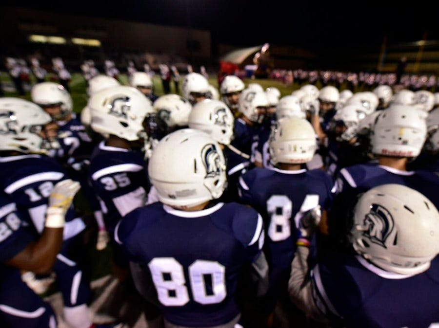 The Chambersburg football team prepares to take the field before playing Central Dauphin on Friday.