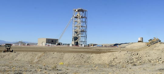 A pad for the mine's mill is being laid next to the main headframe.