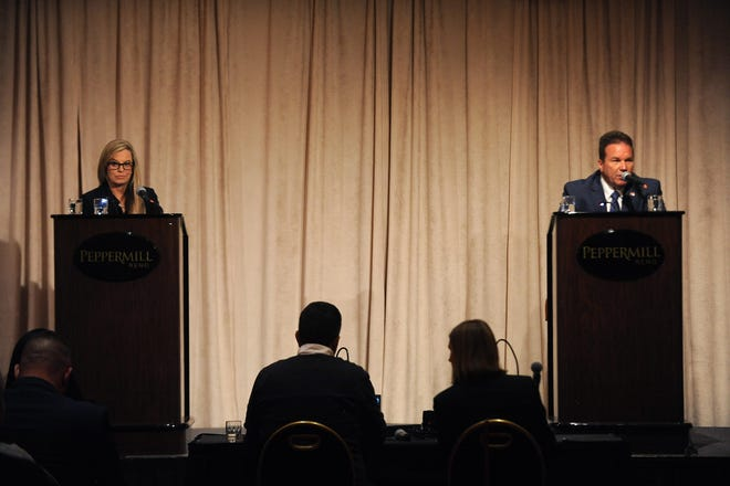 Incumbent Reno Mayor Hillary Schieve, left, and opponent Eddie Lorton take part in a debate at the Peppermill Resort Spa Casino in Reno on Oct. 18, 2018.