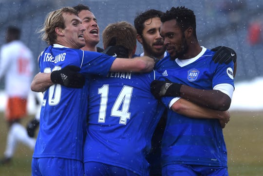 Reno 1868 FC's Chris Wehan (14) gets mobbed by his teammates after scoring against the Swope Park Rangers at Greater Nevada Field in Reno on March 17, 2018. Reno plays Real Monarchs in the USL playoffs on Saturday in Utah