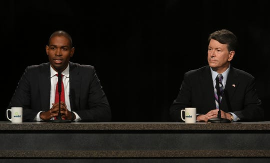 Candidates for the19th Congressional District Antonio Delgado and incumbent John Faso prepare for their debate at the studios of WMHT-TV, Friday Oct. 19, 2018 in East Greenbush, N.Y.