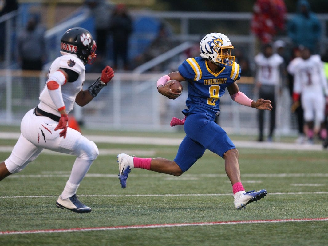 Irondequoit's Freddy June Jr. cuts through the Wilson defense early during Friday night's Section V Class A quarterfinal at Irondequoit.