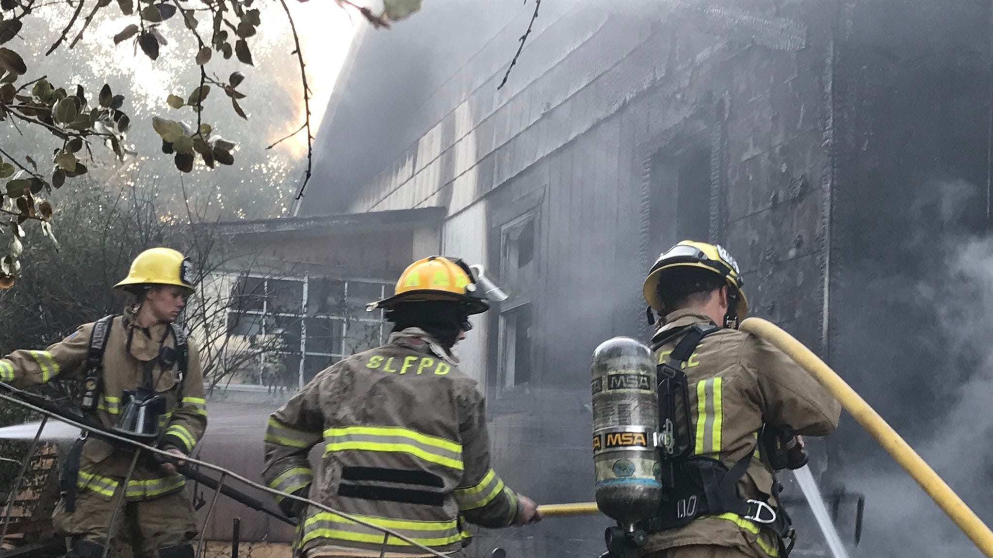 Firefighters at the scene of house fire at Lassen Street and Pine Ave in Shasta Lake. No one was injured in the fire, which broke out around 7:30 a.m.