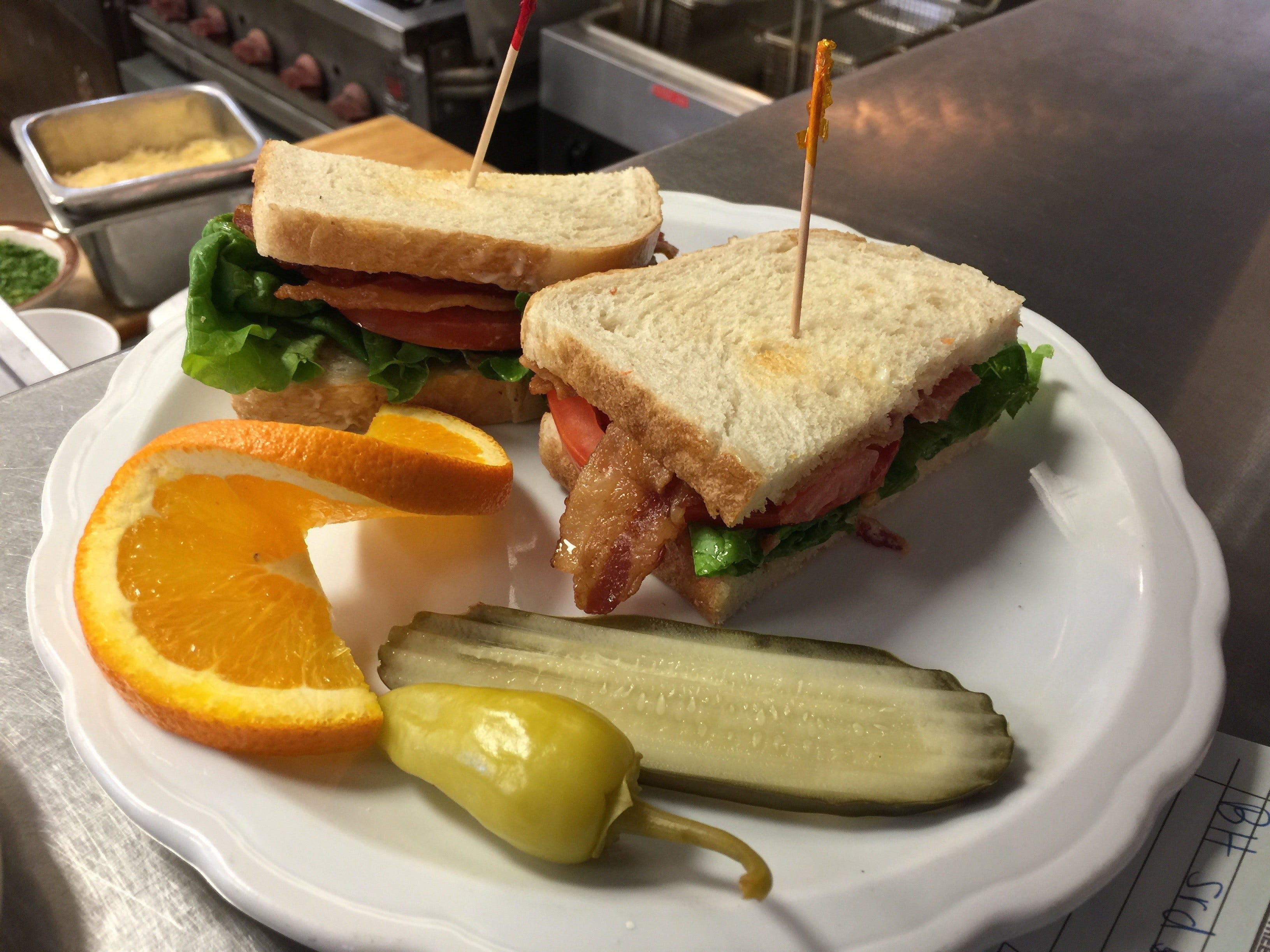 A bacon, lettuce and tomato sandwich lunch item at The Classroom