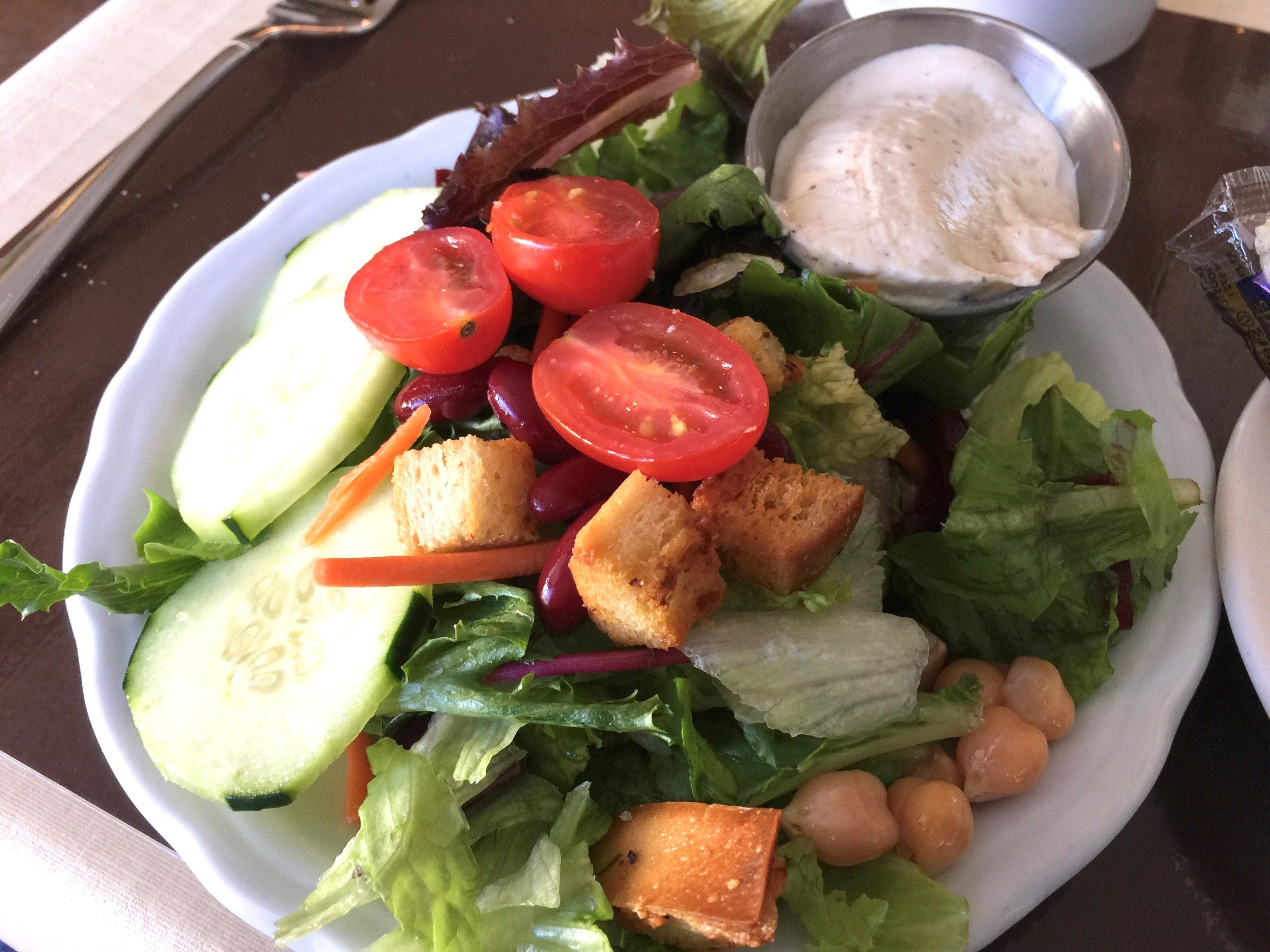 A salad with caesar dressing at The Classroom