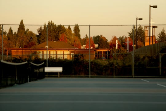 St. Edward's Catholic Church can be seen from the tennis courts at McNary High School in Keizer on Thursday, Oct. 18, 2018.