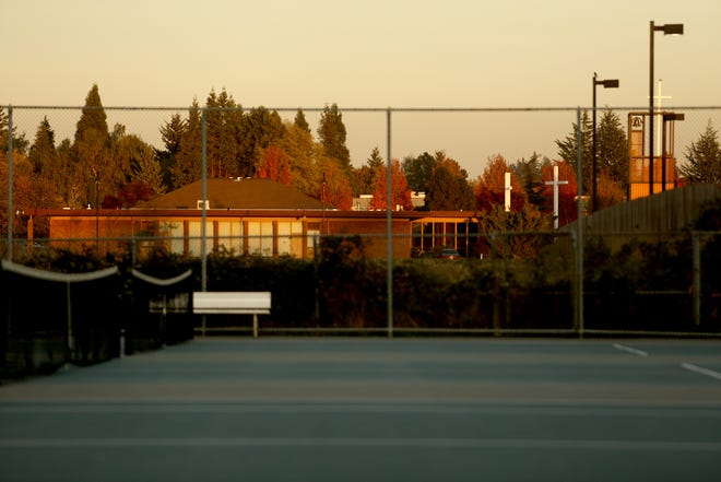 St. Edward Catholic Church can be seen from the tennis courts at McNary High School in Keizer on Thursday, Oct. 18, 2018.