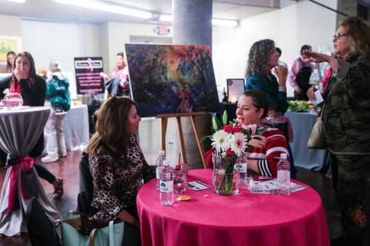 Attendees sample foods and mingle during Shannon's pink pARTy Thursday, Oct. 18, 2018, at San Angelo Museum of Fine Arts.