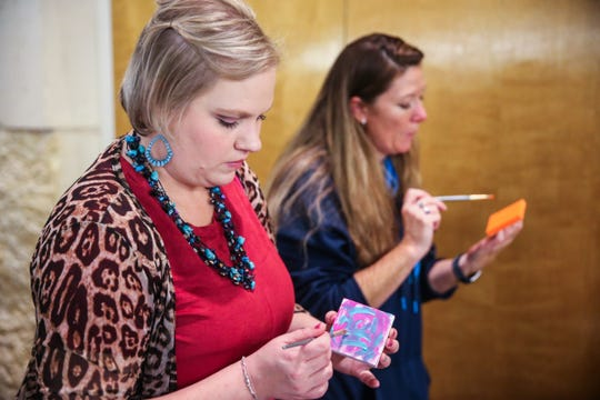 Amanda Terry creates a tiny painting during Shannon's pink pARTy Thursday, Oct. 18, 2018, at San Angelo Museum of Fine Arts.