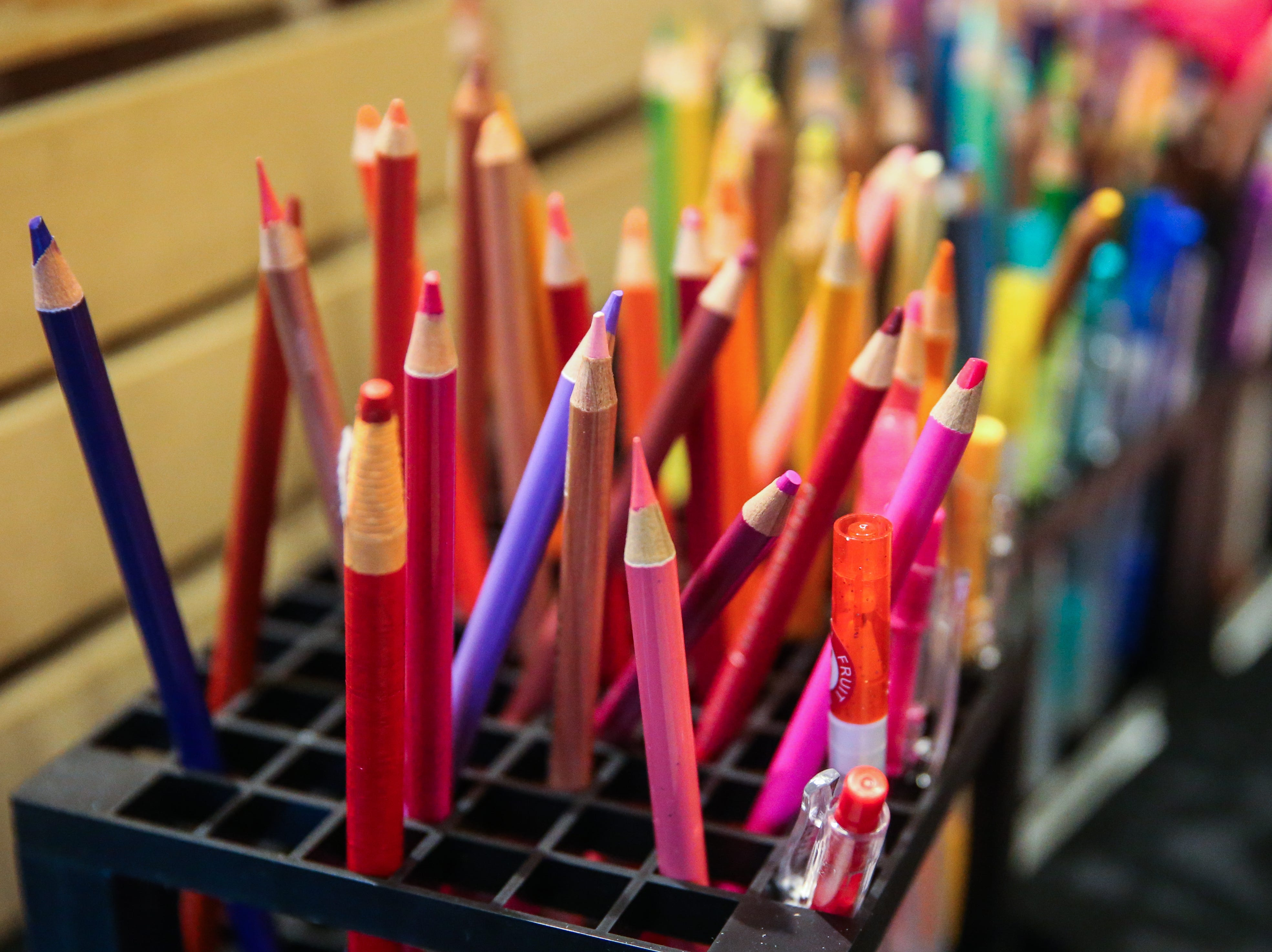 Pencils in a variety of pinks are used by artists to create reaction drawings during Shannon's pink pARTy Thursday, Oct. 18, 2018, at San Angelo Museum of Fine Arts.