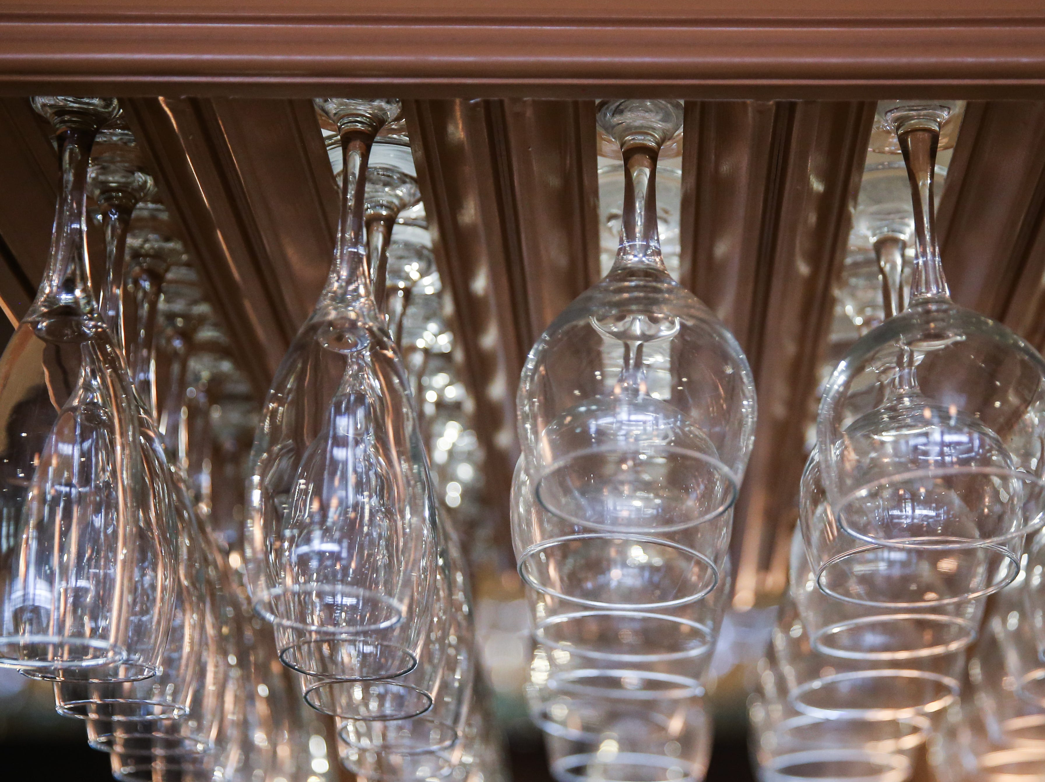 Wine glasses are stacked above the bar at Napoli's Italian Restaurant.