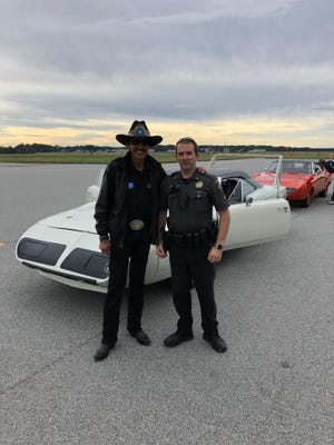"""NASCAR's """"King,"""" Richard Petty, with Talbot County Sheriff's Office Deputy Ryan Andrew at the Easton Airport."""