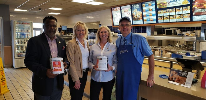 Kola Alayande, District Governor for Rotary, Sheryl Dyksterhouse and Deb Wente, Co-Presidents for Sheboygan Rotary Club and Ken Horkan, the owner of the 3 Sheboygan Culver's.