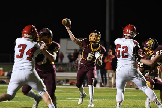 Harrisburg quarterback Jack Teigen (5) throws a pass in action against Yankton on Thursday night in Harrisburg. The Bucks won 28-26 in the final regular season game.