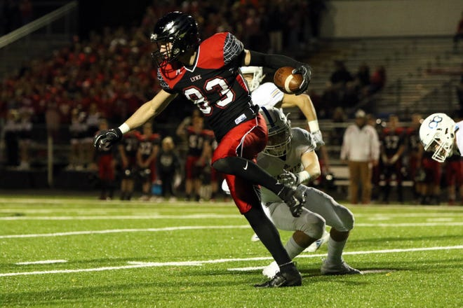 Carter Olthoff of Brandon Valley spins out of the tackle by Noah Reeves of O'Gorman during Thursday night's game in Brandon.