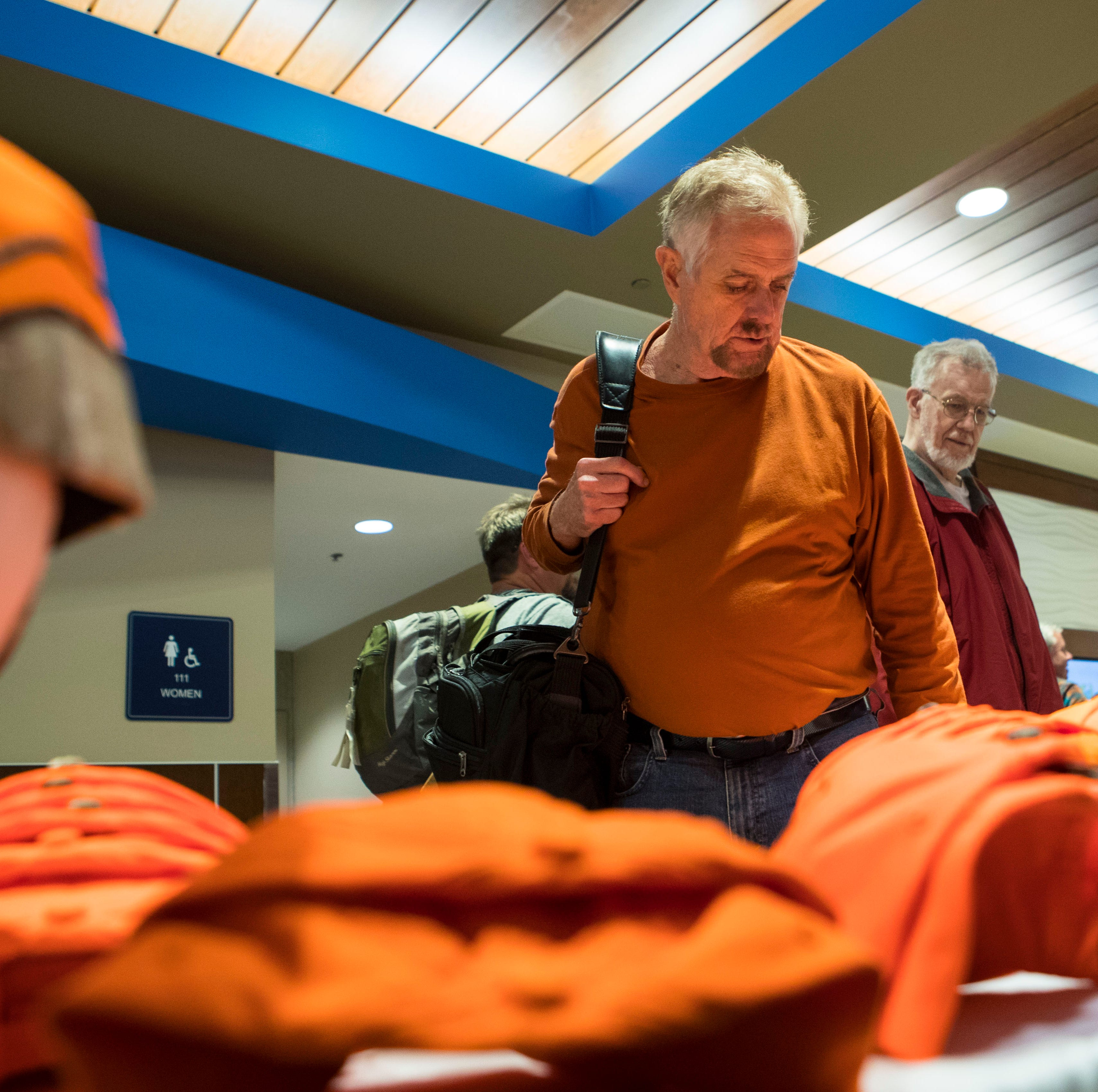 Harry Castle (left) and Greg Peterson look at pheasant hunting hats at Sioux Falls Regional Airport Friday, Oct. 19, 2018.