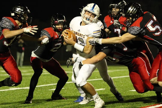 Zach Norton of O'Gorman is surrounded by several Brandon Valley defenders during Thursday night's game in Brandon.